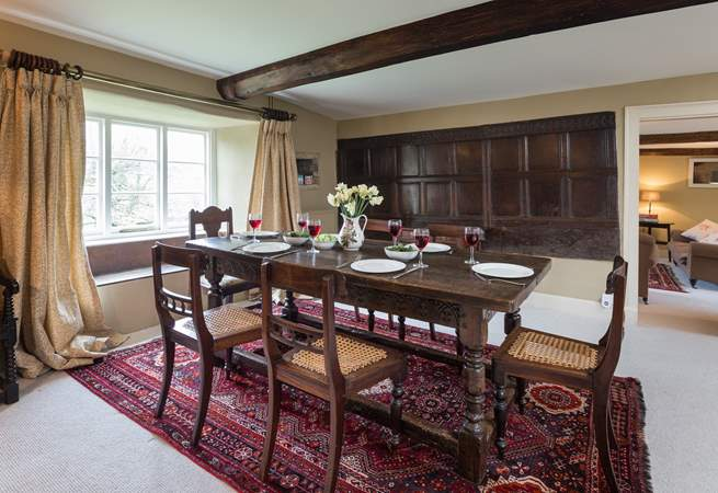 This dining-room still has its historic wooden panelling.