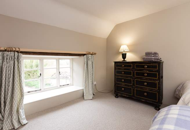 The outlook from this bedroom is at the near end of the farmhouse as you approach down the lane.