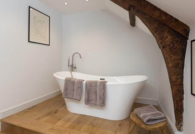 The very stylish family bathroom (the bath is up one step from the rest of the bathroom) is a brand new addition to the farmhouse.