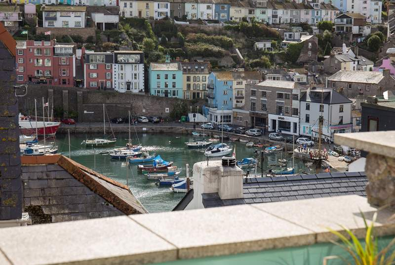 You could almost reach out and touch the harbour from your enclosed terrace.