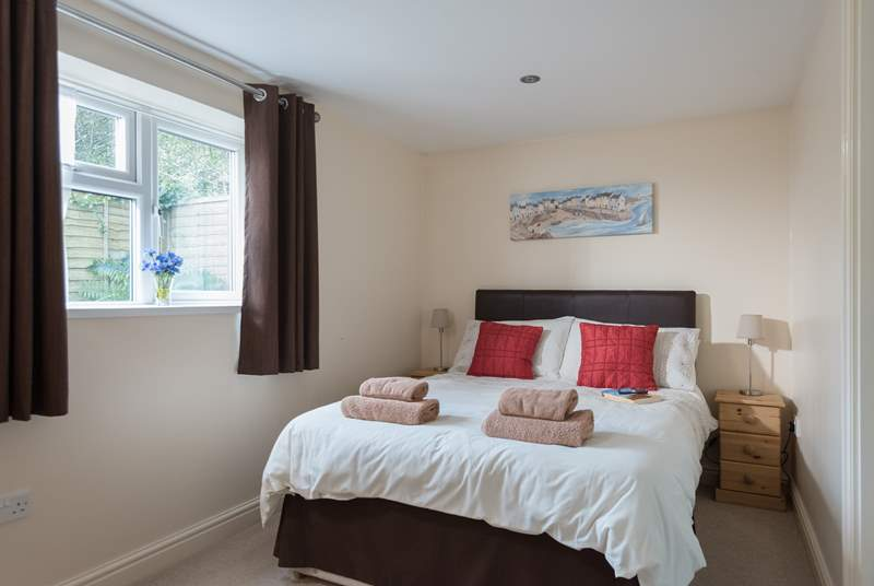 The bedroom is at the rear of the cottage.