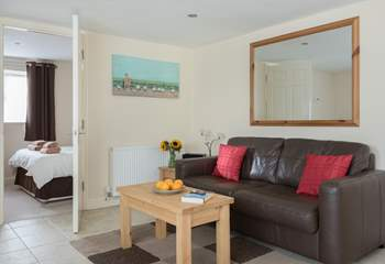The open plan living-room is a relaxing space to return to after a day out exploring.