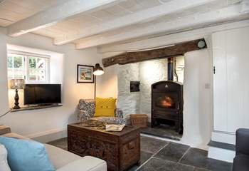 The supersize wood-burner makes the sitting-room warm and cosy all year round.