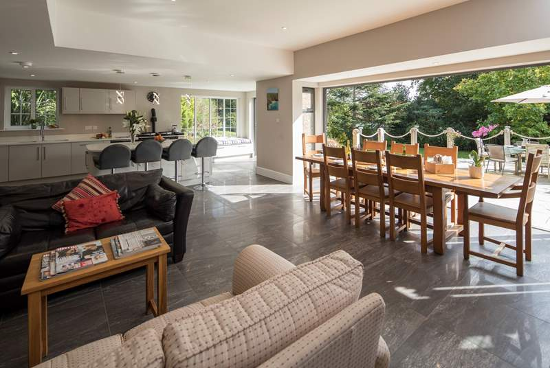 This spacious family home has a fabulous open plan space, with tri-fold doors onto the terrace.