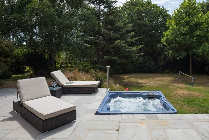 The south-facing terrace catches the sun all day long, who needs to go out exploring, maybe a lazy day beside the hot tub?