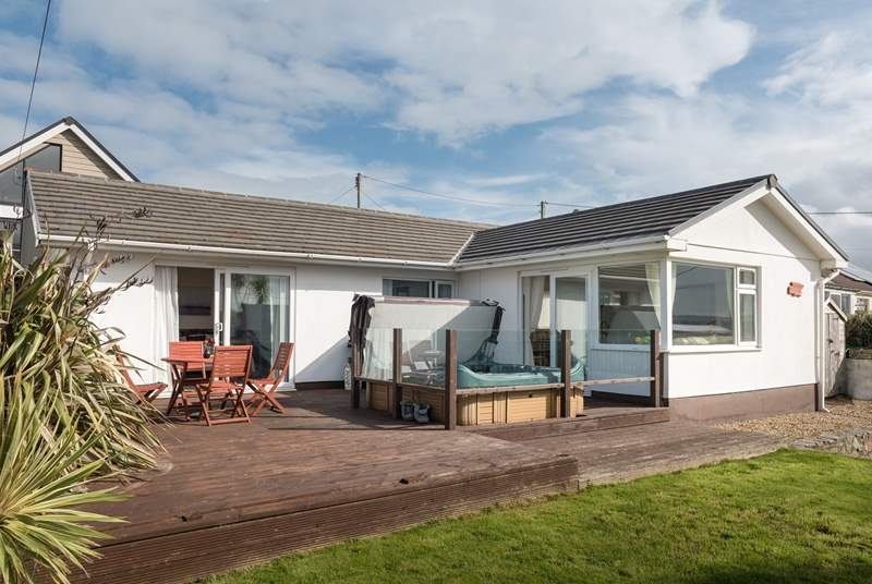 Ocean Breeze is a single-storey property with an enclosed garden and deck.