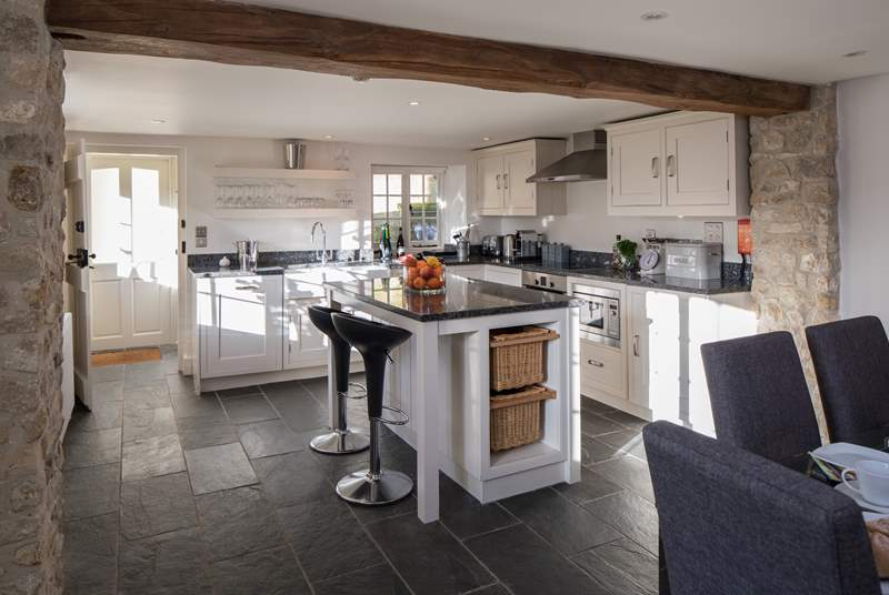 The very modern open plan kitchen/dining-area is great for creating holiday treats to remember; the beam is over 6ft.