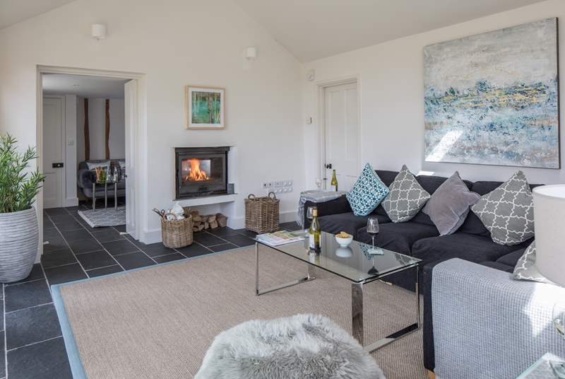 There are two living room areas, the snug and the garden room - there is a fabulous two-sided wood burning stove between the two rooms.
