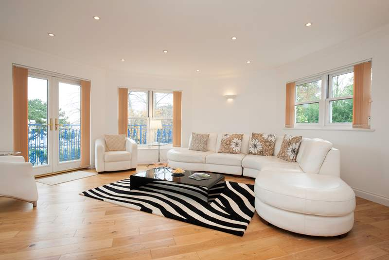 The stunning top floor sitting-room with doors out onto the balcony and far reaching views across the Solent.