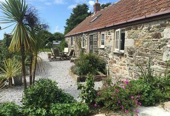 Lavender Barn with private terrace and views over the beautiful gardens and pond of the main house.