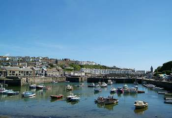 Porthleven's enchanting harbour with its many great restaurants, cafes and shops.