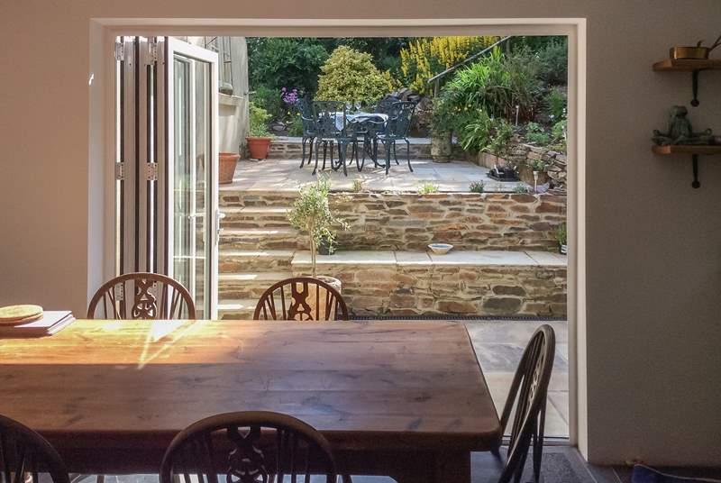 Swing open the bi-fold doors and step out of the kitchen onto the patio. Such a great space for dining al fresco.