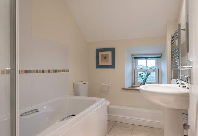 The family bathroom is on the first floor between the twin and double bedrooms.