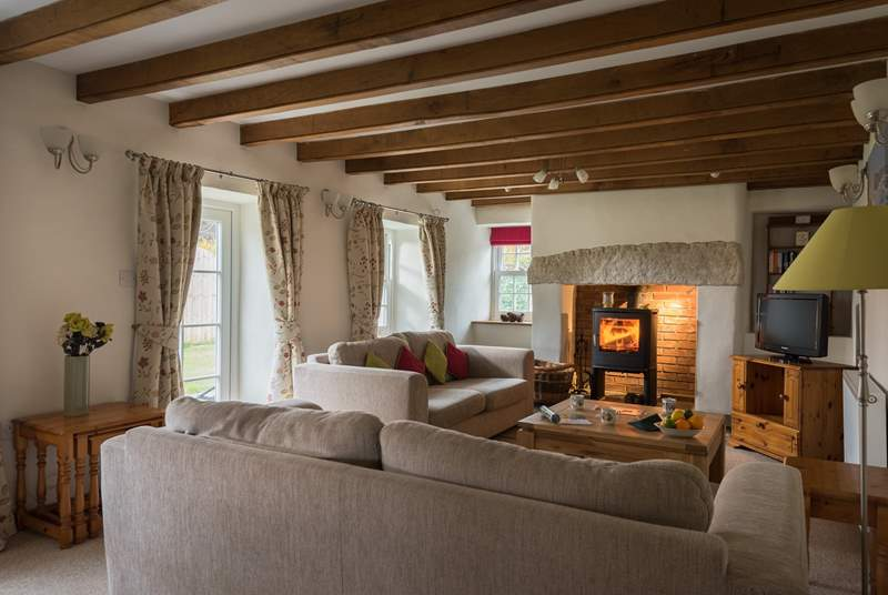 The cosy sitting-room is in the original part of the cottage.