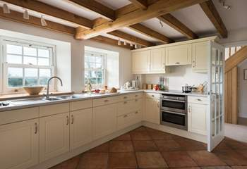 The large kitchen offers an electric hob and electric oven, or the use of a handsome range cooker.