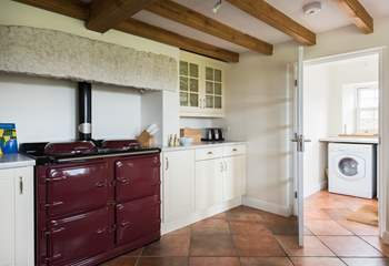 The kitchen boasts a range cooker and separate utility-room by the back door, which leads out to the garden.