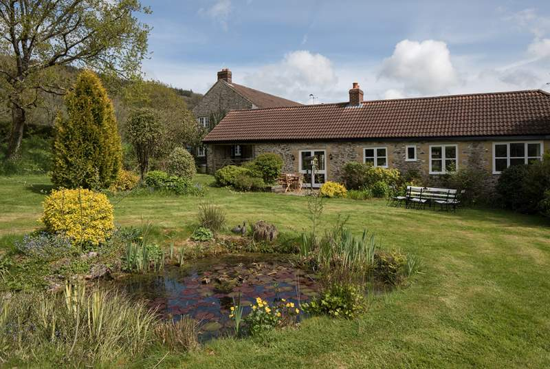 Stable Cottage has French doors that lead out onto a wonderful and really large, lawned garden. The feature pond attracts some amazing birds - do take care with small children though.