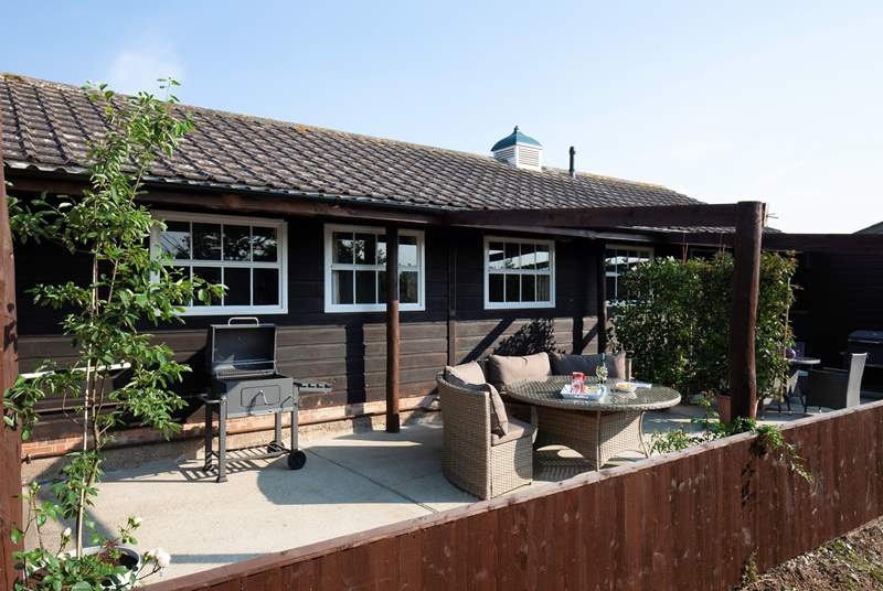 A charming outdoor seating-area with views over Brighstone Downs.
