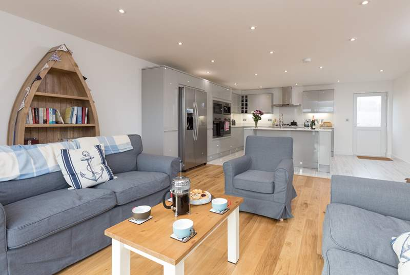 Waterhayes is a stunning new detached house over three floors with two relaxed seating areas - one with a balcony to the front - and a huge deck to the rear.