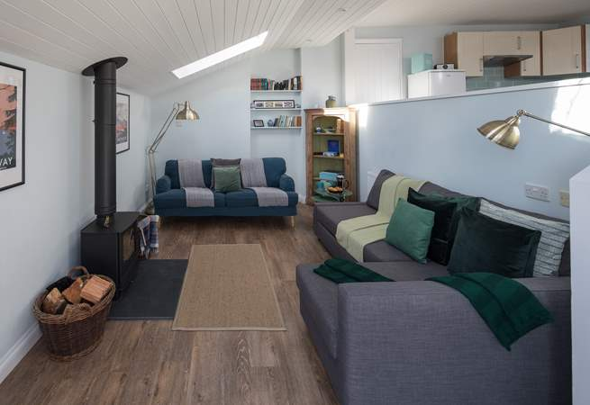 The living-area has a fabulous wood-burner, which sets the perfect scene for cuddling up and enjoying a cosy night in.