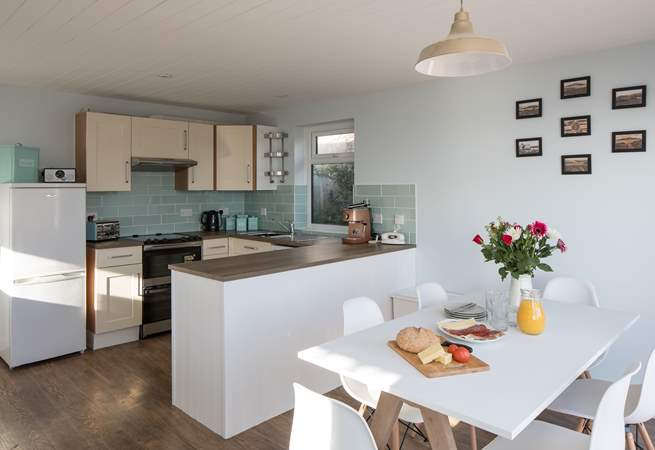 The dining-area is neatly positioned next to the kitchen. Perfect for serving up any meal.