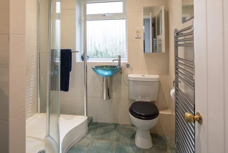 The family bathroom is at the top of the steps, allowing easy access for showering off the sand and salt from a fun packed day on the beach.