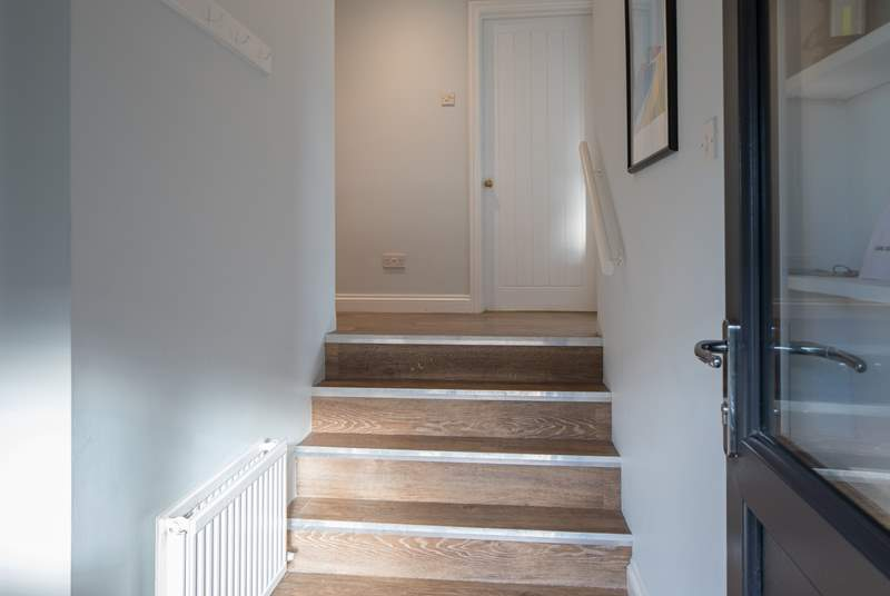 Steps which lead up to the higher level of the house. Please take care as these stairs are narrower than standard steps.