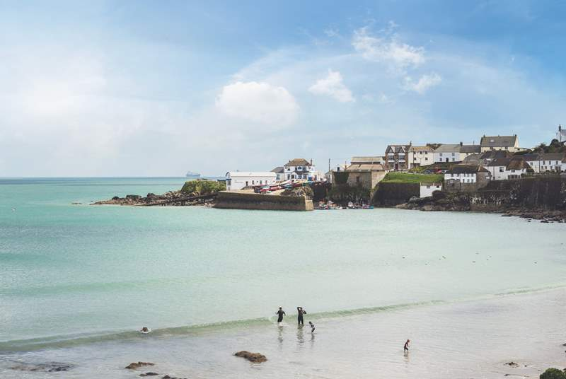 Coverack Bay has a lovely sandy beach at high tide and a windsurfing school.