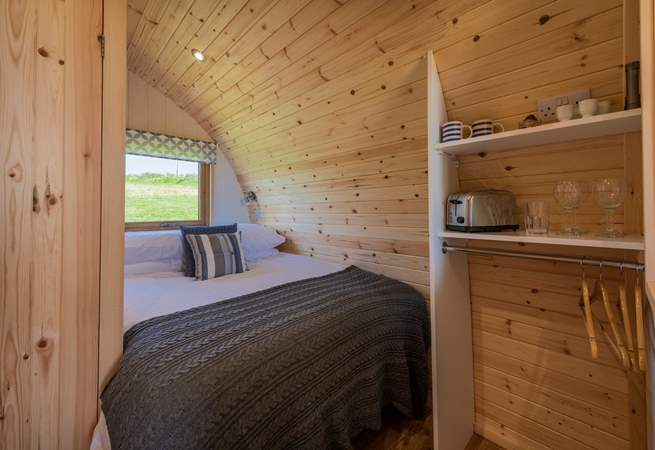 The double bed is tucked into the rear of the pod.