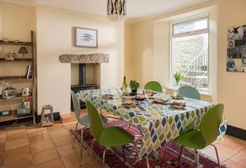 The spacious kitchen/dining-room has a wood-burner (great for cosy meals in cooler months).