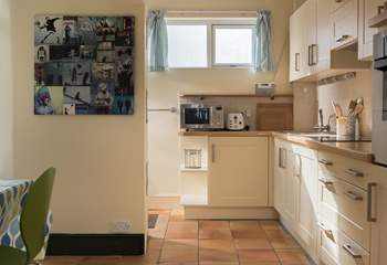 The kitchen area is fully equipped with all you could need for holiday living.