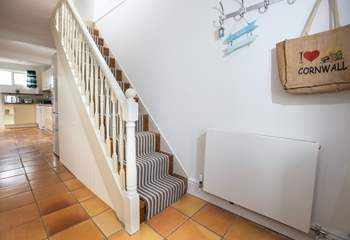 The steep stairs lead to the sitting room which has amazing views, along with the family shower room and second bedroom.