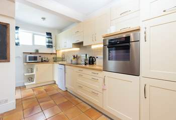The kitchen is well equipped for all your needs and the back door opens into a sheltered, private courtyard.