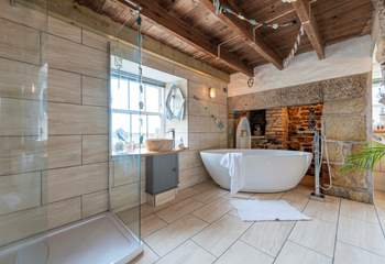 The luxurious bathroom with a free-standing bath and double shower.