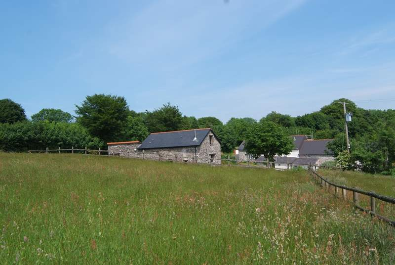 This is the view of the cottage from its own meadow with the historic farmhouse, used by the owners, in the background.