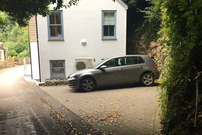 The parking space next to the house for two medium cars can be parked in parallel  to the road or to the house.