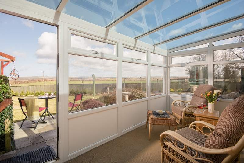 The conservatory takes full advantage of the rural views.