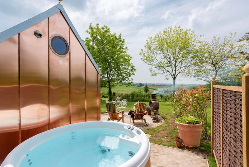 The simply stunning Observatory with blissful bubbling hot tub taking in the glorious countryside views.