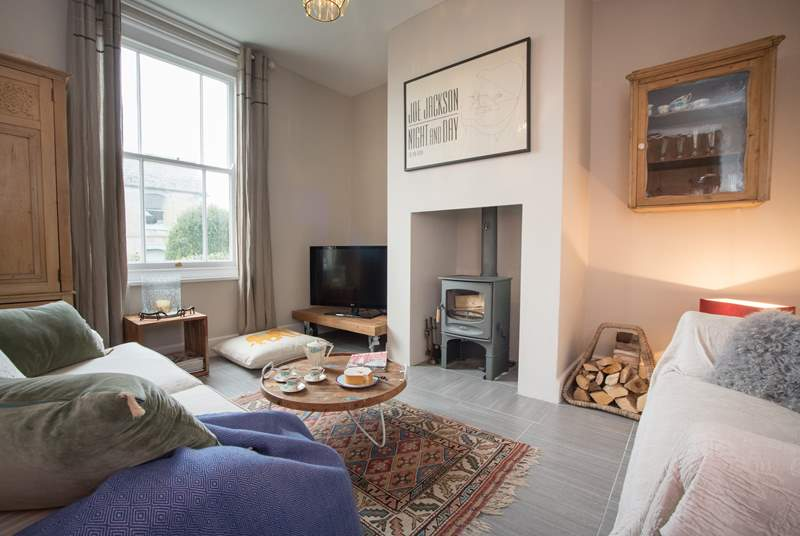 The cosy sitting-room features a wood-burning stove, perfect for the winter months.