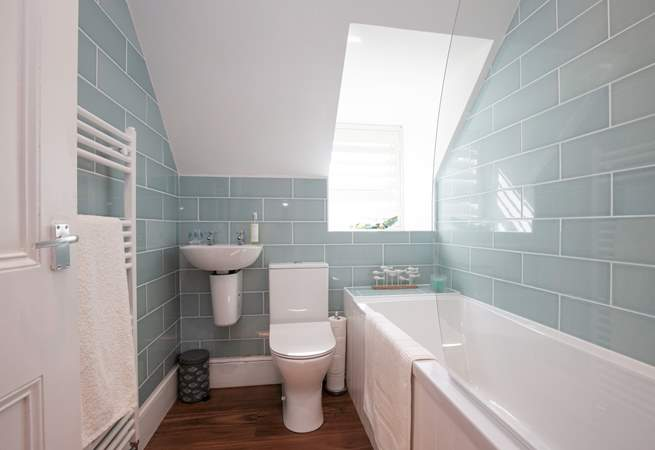 The modern bathroom has been finished with soothing colours, making this an enjoyable place for a long soak in the bath.