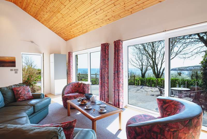 The open plan kitchen and living area has beautiful views towards Portscatho.
