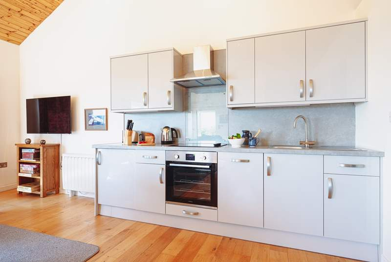 The kitchen area, supplied with all the necessities for your Cornish getaway.