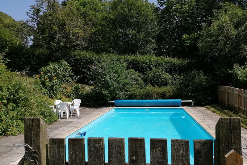 The swimming pool is in a fenced area in the lower gardens of Affeton Castle.