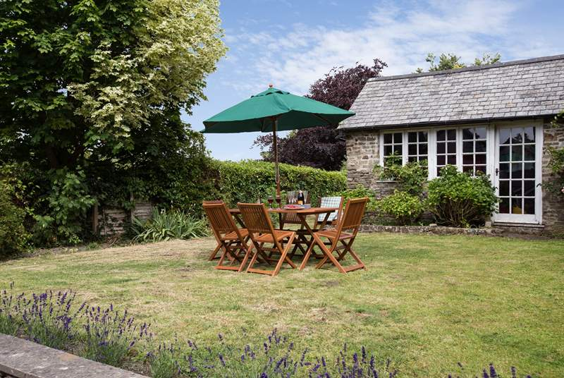 At the back of the cottage there is a wonderful fully enclosed garden with an orchard at the far end. This little stone outbuilding is not in use but guests have a large games-room in the garage.