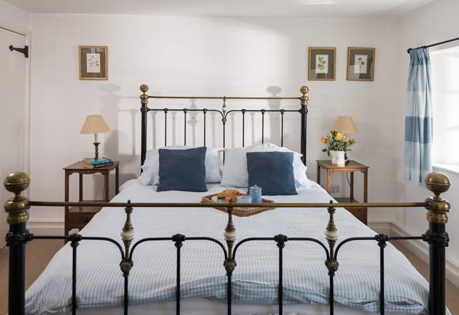 A stylish brass bed in the master bedroom.