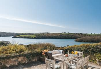 The sunny terrace makes the most of the stunning outlook.