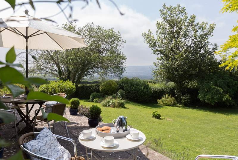 There is a gorgeous terrace overlooking the gardens and with panoromic views above Blagdon Lake to the Mendips.