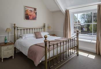 The master bedroom, bedroom 1, has this fabulous 6ft bed; all of the rooms are spacious and elegant with beautiful windows.