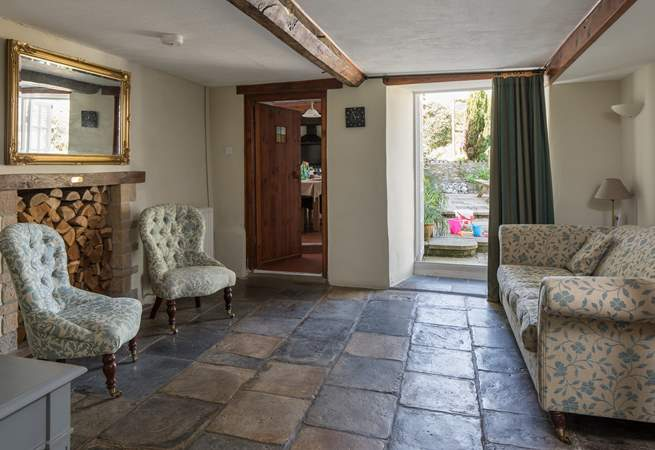 The snug with original stone flooring and French doors onto the patio-area.