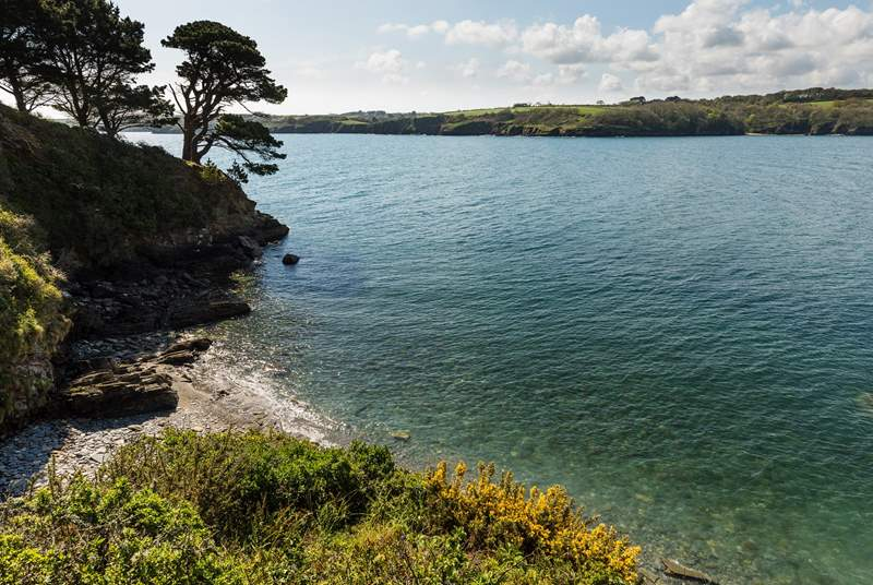 Pretty banks of The Helford are only a short drive away.